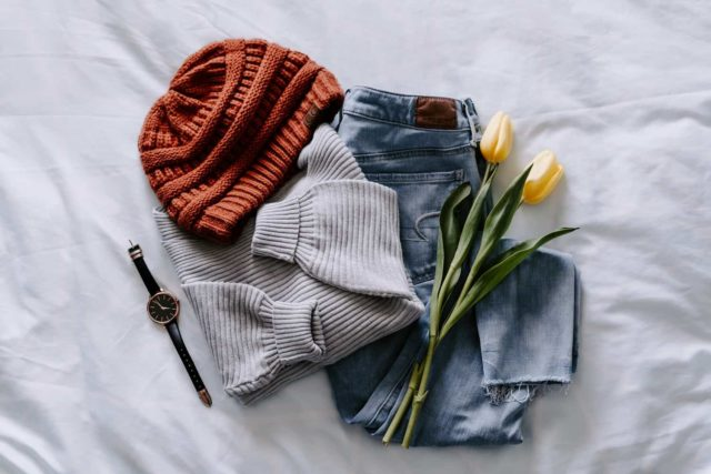 flat lay of used clothing to sell on Poshmark