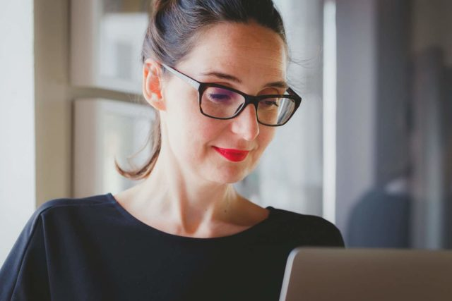 woman proofreading documents online