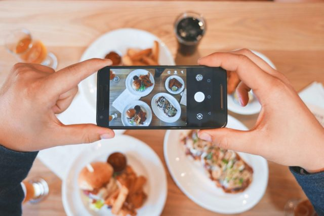 person taking photo for food blog