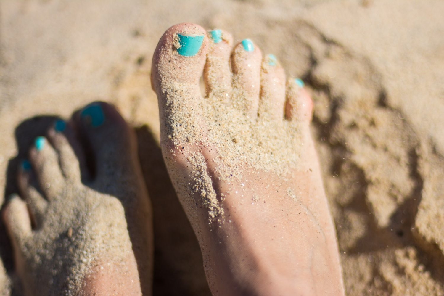woman's feet in sand