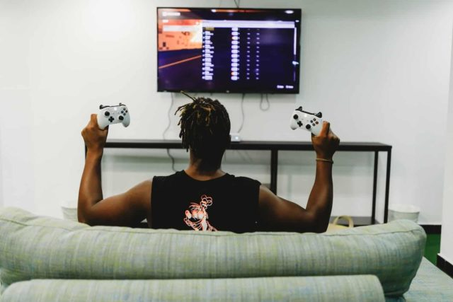 man gaming on Xbox Live Gold