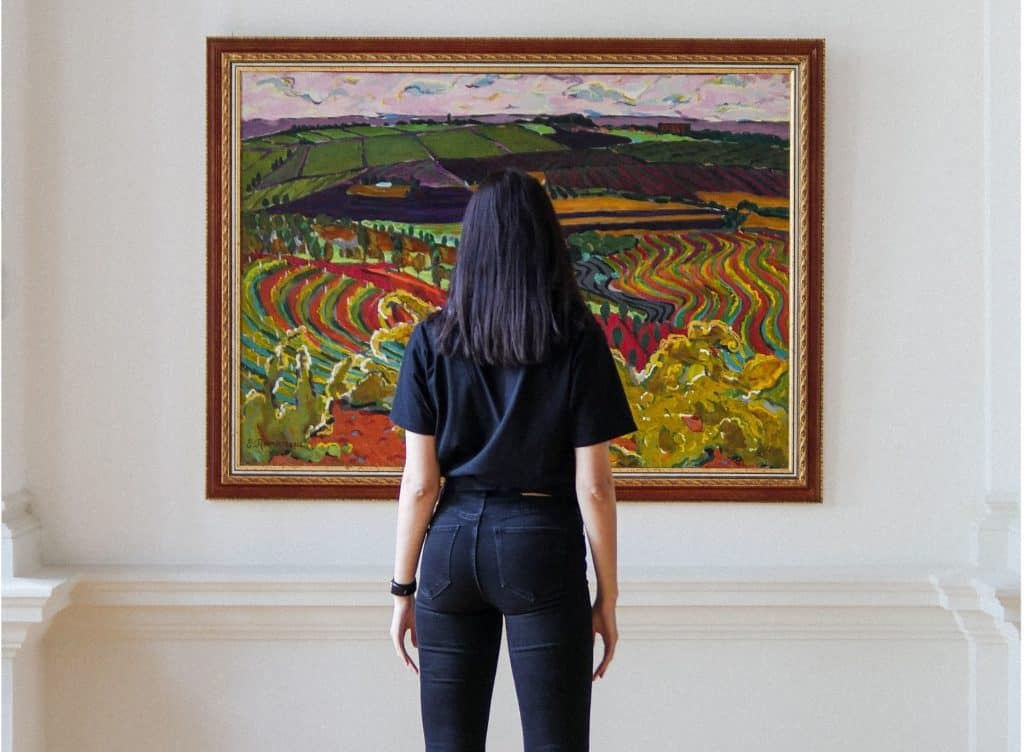 woman looking at fine art piece