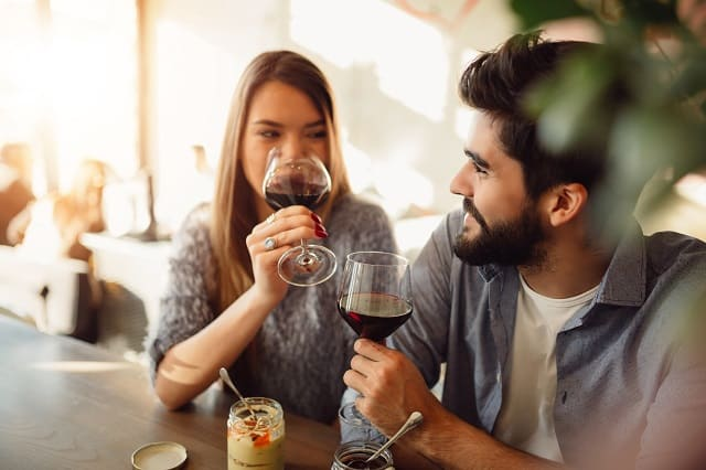 couple getting paid to drink wine