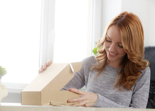 Woman packaging clothes to ship